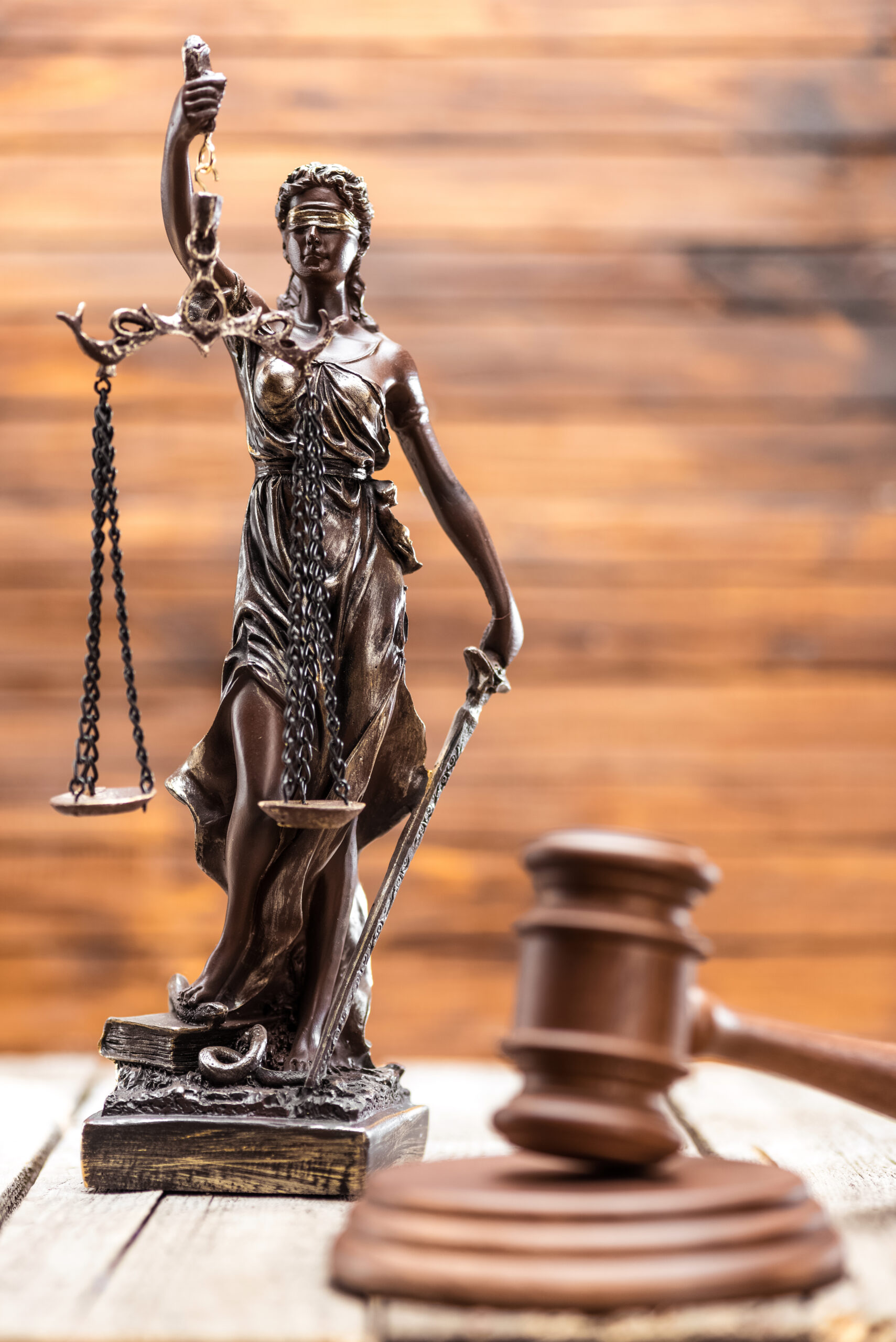 statue-of-lady-justice-and-mallet-on-wooden-table-HV8MLE5-scaled-1.jpg